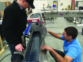 Upender Conveyor features adjustable deflector plate.