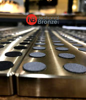 Bronze Slide Bearing Plates Feature Raised Graphite Plugs and Rounded Corners