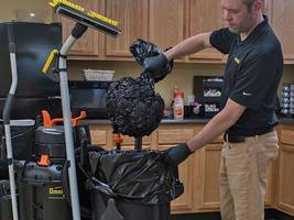 Trash Compacting System Vacuums Air from Trash Cans