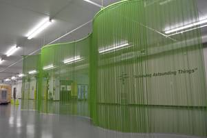 Fabricoil® Interior Partition Used for Wayfinding and an Aesthetic Distraction
