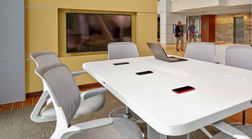New Smart Conference Table Features Wireless Qi Charging for Smartphones
