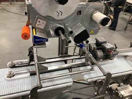 Split Conveyor 'Suspends' Product for Top and Bottom Print/Labeler