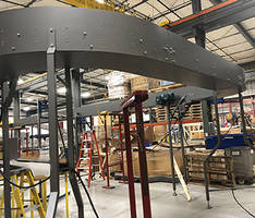 Elevated Conveyor Conserves Critical Floor Space