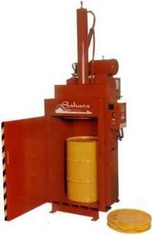 Drum Crusher/Compactor crushes drums down to 4 in.