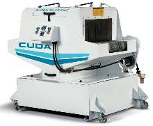 Aqueous Parts Washer cleans parts on assembly line.