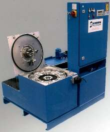 Centrifuge removes oil and sludge from washers.
