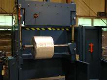 Guillotine Roll Cutter reclaims defective rolls.