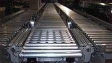Transfer Conveyor features 24 V motorized roller technology.
