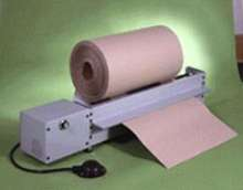 Feeder dispenses rolls of dunnage and wrapping materials.