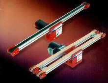 Flat Belt Conveyors provide small part transfer.