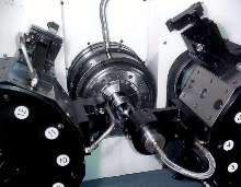 CNC Turning Center incorporates overhead part unloader.