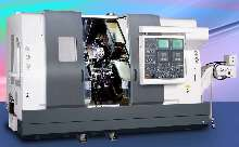 CNC Turning Center simultaneously machines 1 or 2 parts.