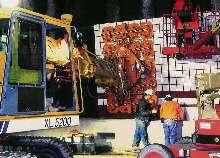 Vacuum End-Effectors bolt onto mobile cranes at job site.