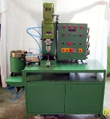 Riveting Machine features vibratory bowl feeder.