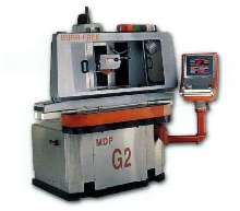 Grinder processes conductive metals.