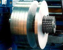 Core Slip Rewinding System provides constant coil tension.