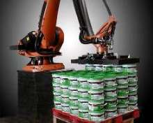 Robot palletizes pails at rate of 50/min.