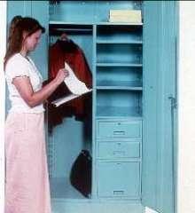 Cabinet combines drawer, shelf, and wardrobe storage.