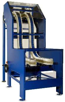 Conveyor elevates products within small space.