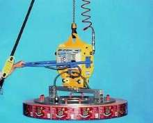 Vacuum Coil Lifter has soft skin foam gripping surface.