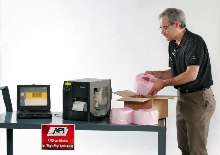 Thermal Transfer Printer offers portable label printing.