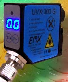 UV Sensor aids in control of adhesive dispensing.