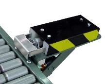 Pusher mounts to many conveyor models.