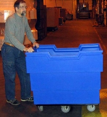 Ergonomic Recycling Cart tilts for smooth, safe rolling.