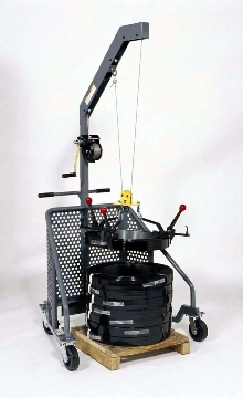 Coil Lifter eliminates manual lifting of strap coils.