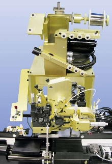 Micro-Coiler System provides coils for automatic assembly.