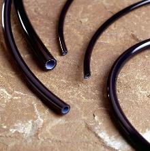 Co-Extruded Tubing combines 2 plastic materials.