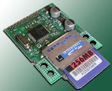 Board adds removable data storage to digital devices.