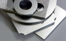 Aircraft Quality Steel is cut into customized shapes.