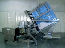 Container Dumper is loaded via pallet jack at floor level.