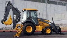 Backhoe incorporates multiple automatic features.