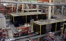 Robotic Welding Cell Enclosure has air filtration unit.