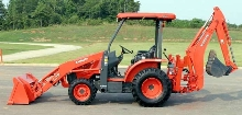 Tractor/Loader/Backhoe is powered by 39 hp diesel engine.