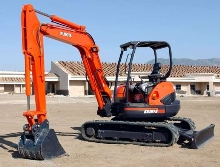 Compact Excavator has floating hydraulic angle blade.