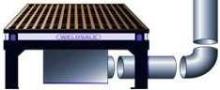 Custom Downdraft System ventilates welding applications.