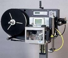 Printer Applicator processes linerless labels.
