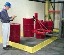 Barrier contains leaks and spills around machinery.