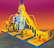 Vacuum Lifter uses oversize pads to grip tooling plate.