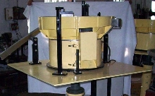 Vibratory Bowl Feeder feeds diodes in rolling orientation.