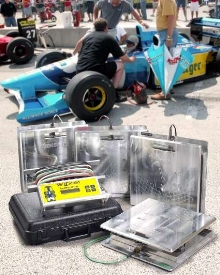 Portable Scale fine tunes weight distribution of race cars.