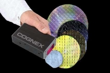 Reader tracks semiconductor wafers through manufacturing.