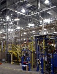 Curtain Enclosures protect robotic welding cells.