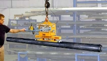 Vacuum Lifter handles pipe from top surface.