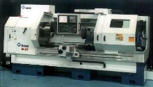 CNC Lathe provides 26.97 in. swing.