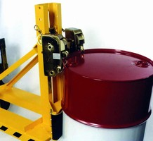 Forklift Attachment handles drums in tight spaces.