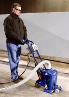 Shot Blasting System prepares concrete surfaces.